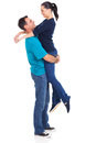 Cheerful caucasian husband lifting his wife over white background Stock Photo