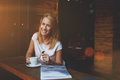 Cheerful caucasian woman with beautiful smile enjoying her recreation time in cozy cafe bar attractive happy hipster girl good Royalty Free Stock Photos