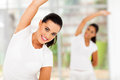 Cheerful caucasian women exercising indoors Royalty Free Stock Images