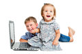 Cheerful children, sitting in front of laptop Royalty Free Stock Photo