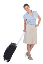 Cheerful classy businesswoman carrying suitcase against white background Royalty Free Stock Photography