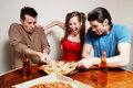 The cheerful company of youth eating a pizza Stock Photos