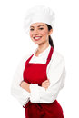 Cheerful confident young female chef pretty baker woman posing with confidence arms folded Royalty Free Stock Photography