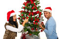 Cheerful couple decorate tree christmas and having fun together Stock Images
