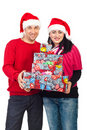 Cheerful couple hold Christmas gifts Royalty Free Stock Image