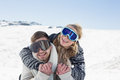 Cheerful couple in ski goggles on snow close up of a men and women covered landscape Royalty Free Stock Image