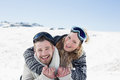 Cheerful couple with ski goggles on snow close up portrait of a men and women covered landscape Stock Photography