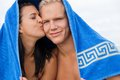 Cheerful couple with a towel covering their heads caucasian young happy made of blond handsome men and an attractive brunette Stock Images