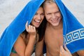 Cheerful couple with a towel covering their heads caucasian young happy made of blond handsome men and an attractive brunette Stock Photo