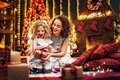 Cheerful cute little girl and her older sister exchanging gifts. Royalty Free Stock Photo
