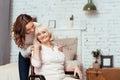 Cheerful Elderly Woman Sittig ...