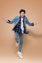Cheerful elegant young handsome asian man jumping. Cool fashion Royalty Free Stock Photo