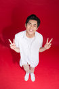 Cheerful elegant young handsome asian man jumping. Cool fashion