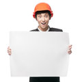 Cheerful engineer woman holding sign surprised in construction helmet isolated on white Stock Photos