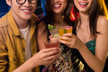 Cheerful evening cropped image of young people clicking in the club Royalty Free Stock Images