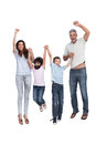 Cheerful family jumping against white background Stock Images