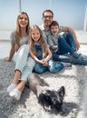 Cheerful family sitting on the floor in the living room Royalty Free Stock Photo