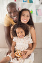 Cheerful family vertical portrait of a mixed posing at camera Stock Photos