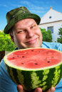 Cheerful farmer with watermelon demonstrating crop Stock Photo