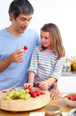 Cheerful father and his daughter having breakfast Royalty Free Stock Photography