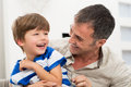 Cheerful father and son happy playing with each other Stock Images