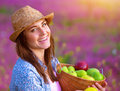 Cheerful female with apple fruits closeup portrait of cute fresh basket in the garden enjoying sunny day harvest season eating Royalty Free Stock Photos
