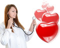 Cheerful female doctor listening heartbeat Stock Photos