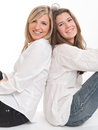 Cheerful female friends two young leaning on each other Royalty Free Stock Images