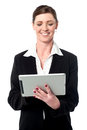 Cheerful female manager using touch pad happy businesswoman watching videos in tablet pc device Stock Photos