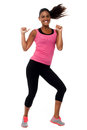 Cheerful fitness trainer filled with enthusiasm excited girl rejoicing and having fun Stock Photo