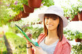 Cheerful florist with flowers beautiful teenager Royalty Free Stock Image