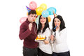 Cheerful friends celebrate birthday three firends women isolated on white background Royalty Free Stock Photo