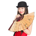 Cheerful girl asian in black hat with a fan mixed race caucasian Stock Image