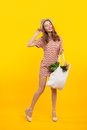Cheerful girl with bag from grocery