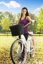 Cheerful girl with a bicycle Royalty Free Stock Photo