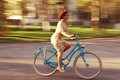 Cheerful girl on a bicycle Royalty Free Stock Photo