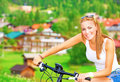 Cheerful girl in bicycle tour Royalty Free Stock Photo