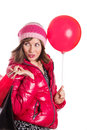 Cheerful girl in coat and hat with bag and balloon Royalty Free Stock Photos