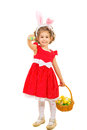 Cheerful girl giving easter egg holding basket with eggs and one colorful isolated on white backgorund Stock Photos