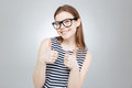 Cheerful girl in glasses showing thumbs up with both hands Royalty Free Stock Photo