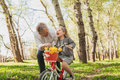 Cheerful girl with grandfather riding bicycle Royalty Free Stock Photo