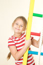 Cheerful girl near the sports equipment Royalty Free Stock Image