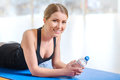 Cheerful girl resting after sport activities Royalty Free Stock Photo