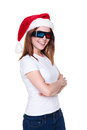 Cheerful girl in santa hat and 3d glasses Stock Images