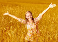 Cheerful girl on wheat field Royalty Free Stock Photo
