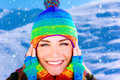 Cheerful girl in winter park closeup portrait of teen having fun wearing stylish colorful hat and gloves enjoying falling snow and Stock Photos