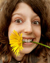 Cheerful girl and yellow camomile Royalty Free Stock Image