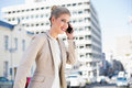 Cheerful gorgeous businesswoman having a phone call Royalty Free Stock Photo