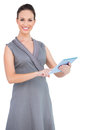Cheerful gorgeous woman holding digital tablet posing on white background Royalty Free Stock Image