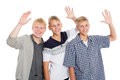 Cheerful group of young boys with their hands raised in greeting two the twin brothers Stock Image